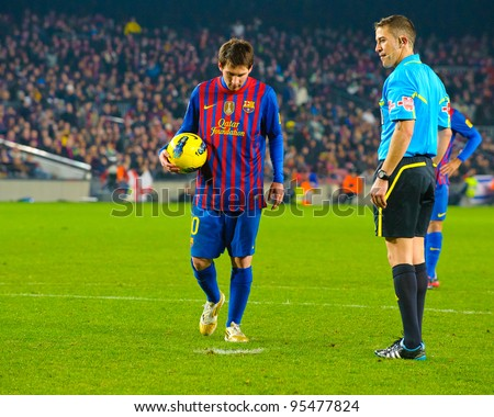BARCELONA – JAN 15: Leo Messi (L) in a penalty kick during the match between FC Barcelona vs Real Betis, 4 - 2, in Camp Nou stadium on January 15, 2012, Barcelona, Spain. - stock photo