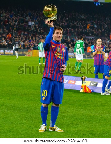 BARCELONA – JAN. 15: Leo Messi poses with FIFA World Player Gold Ball Award in Camp Nou stadium before the match between FC Barcelona vs Betis, on January 15, 2012, Barcelona, Spain. - stock photo