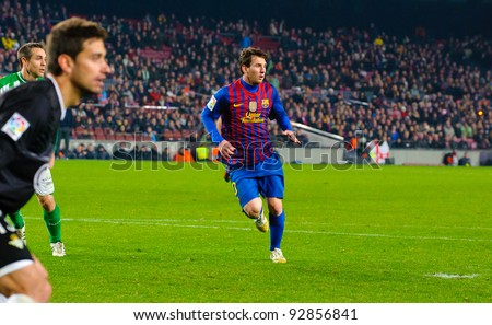 BARCELONA – JAN. 15: Leo Messi (R) in action during the match between FC Barcelona vs Real Betis, 4 - 2, in Camp Nou stadium on January 15, 2012, Barcelona, Spain. - stock photo