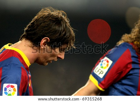 BARCELONA - JAN 12: Messi of Barcelona during a Spanish Cup match between FC Barcelona and Real Betis at the Nou Camp Stadium on January 12, 2011 in Barcelona, Spain - stock photo