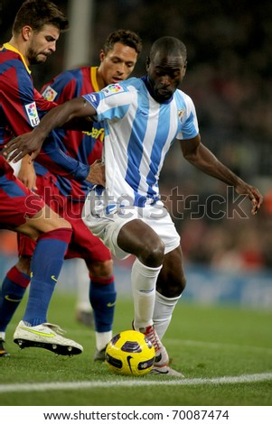 BARCELONA - JAN 16: Quincy Owusu-Abeyie of Malaga in action during the match between FC Barcelona and Malaga CF at the Nou Camp Stadium on January 16, 2011 in Barcelona, Spain