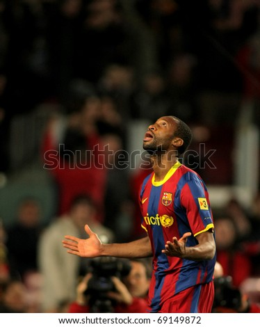 BARCELONA - JAN 12: Seydou Keita of Barcelona during a Spanish Cup match between FC Barcelona and Real Betis at the Nou Camp Stadium on January 12, 2011 in Barcelona, Spain - stock photo