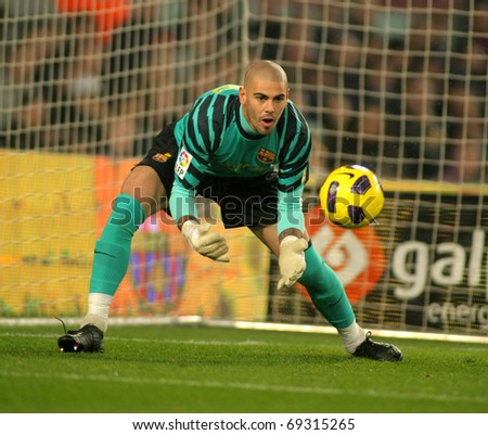 BARCELONA - JAN 12: Victor Valdes of Barcelona in action during the match between FC Barcelona and Real Betis at the Nou Camp Stadium on January 12, 2011 in Barcelona, Spain - stock photo