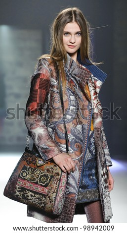 BARCELONA - JANUARY 27: A model walks on the Desigual catwalk during the 080 Barcelona Fashion runway on January 27, 2012 in Barcelona, Spain. - stock photo