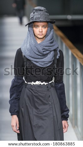BARCELONA - JANUARY 29: A model walks on the Miriam Ponsa catwalk during the 080 Barcelona Fashion runway Fall/Winter 2014 on January 29, 2014 in Barcelona, Spain.
