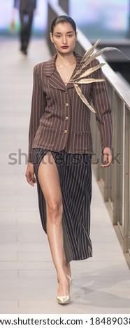 BARCELONA - JANUARY 30: A model walks on the Naulover catwalk during the 080 Barcelona Fashion runway Fall/Winter 2014 on January 30, 2014 in Barcelona, Spain.  - stock photo