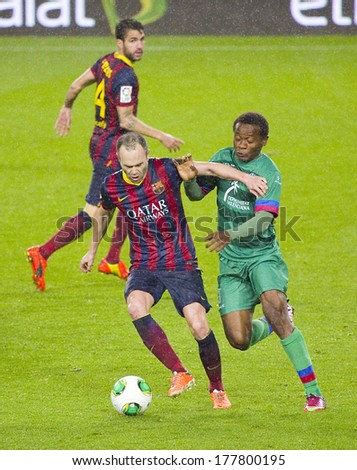 BARCELONA - JANUARY 29: Andres Iniesta (L) in action at Copa del Rey - Spanish Cup - match between FC Barcelona and Levante, 5-1, under an intense rain, on January 29, 2014, in Barcelona, Spain.