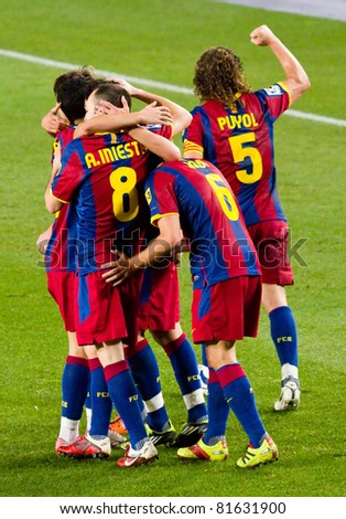 BARCELONA - JANUARY 16: Barcelona players celebrating a goal during Spanish League match between FC Barcelona and Malaga, 4 - 1. January 16, 2011 in Camp Nou stadium, Barcelona, Spain.