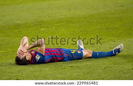 BARCELONA - JANUARY 25: Cesc Fabregas at the Spanish Cup match between FC Barcelona and Real Madrid, final score 2 - 2, on January 25, 2012, in Camp Nou, Barcelona, Spain. - stock photo
