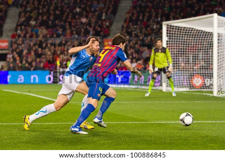 BARCELONA - JANUARY 4: Cesc Fabregas (4) of Barcelona in action at the Spanish Cup match between FC Barcelona and Osasuna, final score 4 - 0, on January 4, 2012 in Camp Nou stadium, Barcelona, Spain. - stock photo
