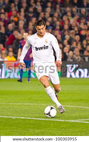 BARCELONA - JANUARY 25: Cristiano Ronaldo of Madrid in action during the Spanish Cup match between FC Barcelona and Real Madrid, final score 2 - 2, on January 25, 2012, in Barcelona, Spain. - stock photo
