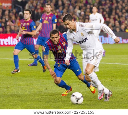 BARCELONA - JANUARY 25: Cristiano Ronaldo (R) in action at the Spanish Cup match between FC Barcelona and Real Madrid, final score 2 - 2, on January 25, 2012, in Camp Nou, Barcelona, Spain.