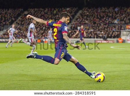 BARCELONA - JANUARY 4: Dani Alves of FCB in action at the Spanish League match between FC Barcelona and Osasuna, final score 5 - 1, on January 27, 2013, in Barcelona, Spain.