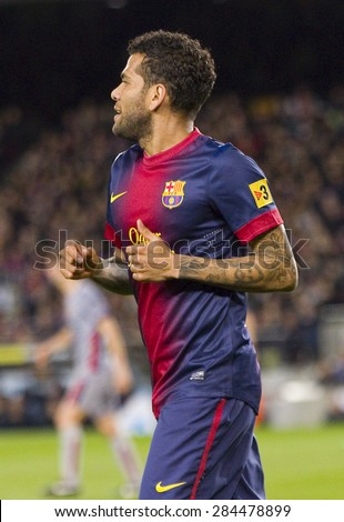 BARCELONA - JANUARY 4: Dani Alves of FCB in action at the Spanish League match between FC Barcelona and Osasuna, final score 5 - 1, on January 27, 2013, in Barcelona, Spain. - stock photo