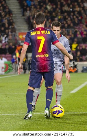 BARCELONA - JANUARY 27: David Villa of FCB (7) in action at the Spanish League match between FC Barcelona and Osasuna, final score 5 - 1, on January 27, 2013, in Barcelona, Spain. - stock photo