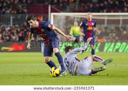 BARCELONA - JANUARY 27: David Villa of FCB (L) in action at the Spanish League match between FC Barcelona and Osasuna, final score 5 - 1, on January 27, 2013, in Barcelona, Spain. - stock photo