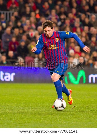 BARCELONA - JANUARY 4: Leo Messi of Barcelona in action during the Spanish Cup match between FC Barcelona and Osasuna, final score 4 - 0, on January 4, 2012 in Camp Nou stadium, Barcelona, Spain. - stock photo