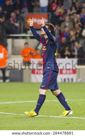 BARCELONA - JANUARY 4: Lionel Messi celebrating his goal at the Spanish League match between FC Barcelona and Osasuna, final score 5 - 1, on January 27, 2013, in Barcelona, Spain. - stock photo
