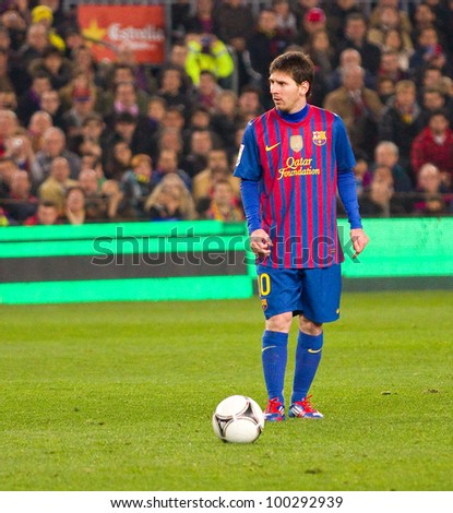 BARCELONA - JANUARY 25: Lionel Messi of Barcelona in action during the Spanish Cup match between FC Barcelona and Real Madrid, final score 2 - 2, on January 25, 2012, in Camp Nou, Barcelona, Spain. - stock photo