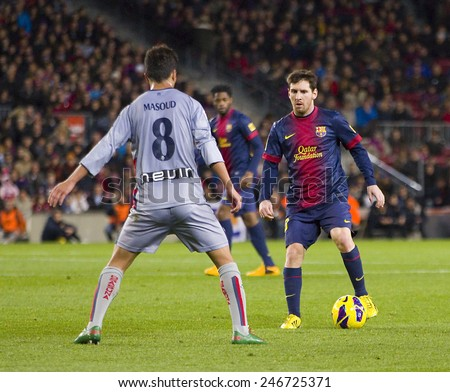 BARCELONA - JANUARY 27: Lionel Messi of FCB (R) in action at the Spanish League match between FC Barcelona and Osasuna, final score 5 - 1, on January 27, 2013, in Barcelona, Spain. - stock photo