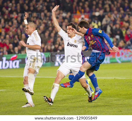 BARCELONA - JANUARY 25: Lionel Messi (R) in action at the Spanish Cup match between FC Barcelona and Real Madrid, final score 2 - 2, on January 25, 2012, in Barcelona, Spain. - stock photo