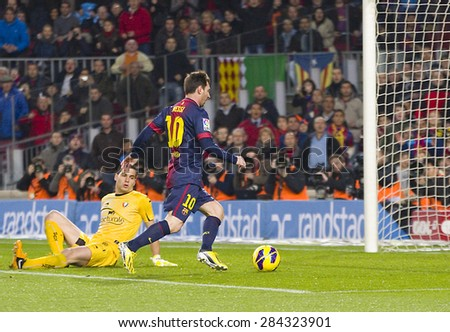 BARCELONA - JANUARY 4: Lionel Messi (10) scores a goal at the Spanish League match between FC Barcelona and Osasuna, final score 5 - 1, on January 27, 2013, in Barcelona, Spain. - stock photo