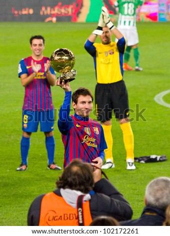 BARCELONA - JANUARY 15: Lionel Messi shows his third FIFA World Player Gold Ball Award to the soccer supporters of Football Club Barcelona, on January 15, 2012 in Nou Camp stadium, Barcelona, Spain. - stock photo