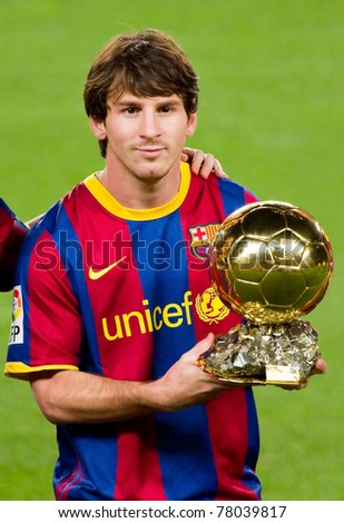 BARCELONA - JANUARY 12: Lionel Messi shows the FIFA World Player Gold Ball Award to the soccer supporters of Football Club Barcelona, on January 12, 2011 in Nou Camp stadium, Barcelona, Spain. - stock photo