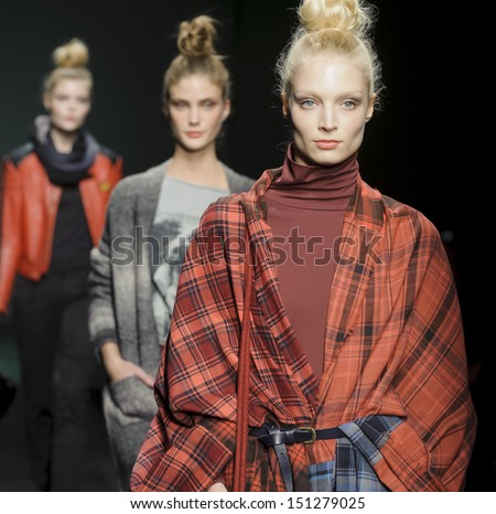 BARCELONA - JANUARY 31: Models walking on the Yerse catwalk during the 080 Barcelona Fashion runway on January 31, 2013 in Barcelona, Spain.  - stock photo
