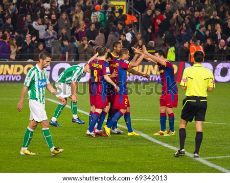 BARCELONA - JANUARY 12: Nou Camp football stadium, soccer Spanish Cup: FC Barcelona - Real Betis, 5 - 0. In the picture, players celebrating a goal. January 12, 2011 in Barcelona (Spain). - stock photo