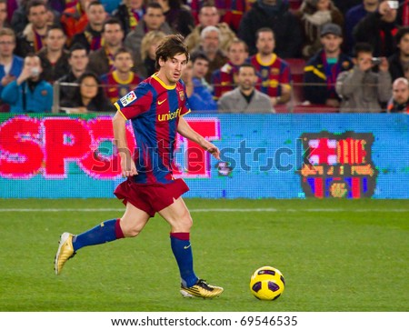 BARCELONA - JANUARY 12: Nou Camp football stadium, soccer Spanish Cup: FC Barcelona - Real Betis, 5 - 0. In the picture, Leo Messi in action. January 12, 2011 in Barcelona (Spain). - stock photo