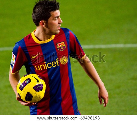 BARCELONA - JANUARY 16: Nou Camp football stadium, soccer Spanish League match: FC Barcelona - Malaga, 4 - 1. In the picture, David Villa. January 16, 2011 in Barcelona (Spain). - stock photo