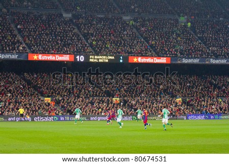 BARCELONA - JANUARY 12: Some players in action during the football Spanish Cup match between FC Barcelona and Real Betis, final score 5 - 0, on January 12, 2011 in Camp Nou stadium, Barcelona, Spain.