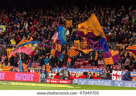 BARCELONA - JANUARY 4: Unidentified supporters celebrating a goal during the Spanish Cup match between FC Barcelona and Osasuna, final score 4 - 0, on January 4, 2012 in Camp Nou, Barcelona, Spain. - stock photo