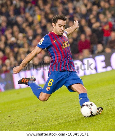 BARCELONA - JANUARY 4: Xavi Hernandez of Barcelona in action during the Spanish Cup match between FC Barcelona and Osasuna, final score 4 - 0, on January 4, 2012 in Camp Nou stadium, Barcelona, Spain. - stock photo