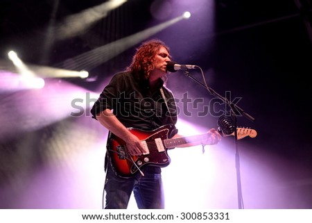 BARCELONA - JUL 3: Adam Granduciel, frontman of The War on Drugs (indie rock band), performs at Vida Festival on July 3, 2015 in Barcelona, Spain. - stock photo