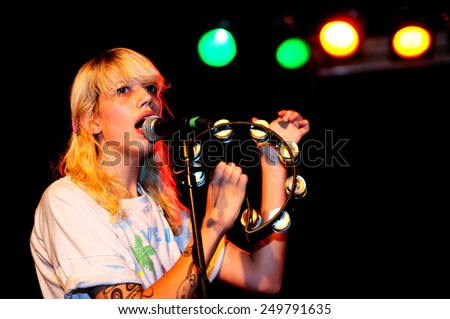BARCELONA - JUL 27: Cassie Ramone, from Vivian Girls (band), performs at Discotheque Razzmatazz on July 27, 2010 in Barcelona, Spain. - stock photo