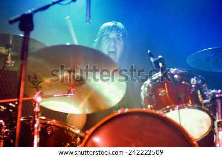 BARCELONA - JUL 2: The drummer of Sidonie (band) perfoms at Bikini stage on July 2, 2010 in Barcelona, Spain. - stock photo