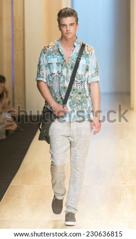 BARCELONA - JULY 02: a model walks on the Custo Barcelona catwalk during the 080 Barcelona Fashion runway Spring/Summer 2015 on July 02, 2014 in Barcelona, Spain.  - stock photo