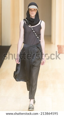 BARCELONA - JULY 02: a model walks on the Miriam Ponsa catwalk during the 080 Barcelona Fashion runway Spring/Summer 2015 on July 02, 2014 in Barcelona, Spain.