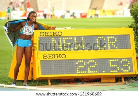 BARCELONA - JULY, 13: Anthonique Strachan of Bahamas celebrating her record during the 20th World Junior Athletics Championships at the Olympic Stadium on July 13, 2012 in Barcelona, Spain - stock photo