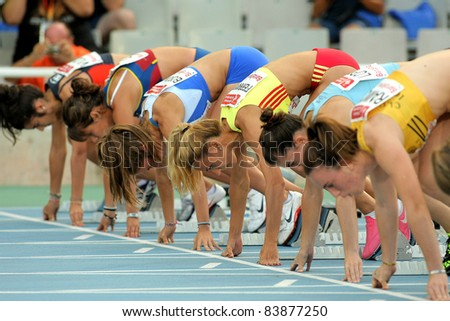 BARCELONA - JULY 22: Athletes ready on the start of 100m Event of Barcelona Athletics meeting at the Olympic Stadium on July 22, 2011 in Barcelona, Spain