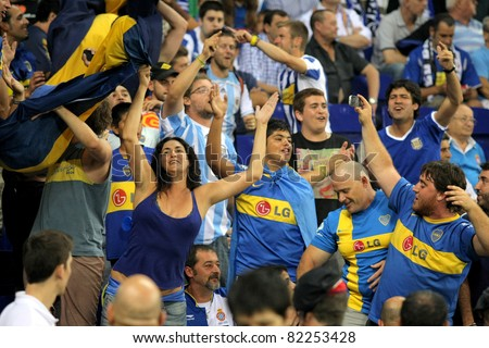 BARCELONA - JULY 28: Boca Juniors supporters during a friendly match against RCD Espanyol at the Estadi Cornella on July 28, 2011 in Barcelona, Spain - stock photo