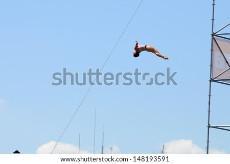BARCELONA - JULY 30: Cesilie Carlton, jumps from the High Diving Tower at the final of women's high altitude jumps at Barcelona Swimming World Championship on July 30, 2013 in Barcelona, Spain.