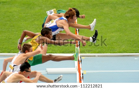 BARCELONA - JULY 10: Competitors of 110 meters hurdles during the 20th World Junior Athletics Championships at the Olympic Stadium on July 10, 2012 in Barcelona, Spain - stock photo