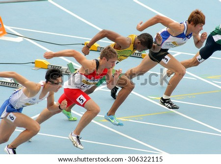 BARCELONA - JULY, 10: Competitors on start of 110m men hurdles during the 20th World Junior Athletics Championships at the Olympic Stadium on July 10, 2012 in Barcelona, Spain - stock photo