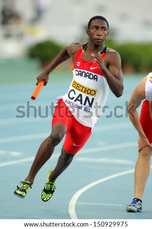BARCELONA - JULY, 14: Drelan Bramwell of Canada in action during 4X400 Relay of the 20th World Junior Athletics Championships at the Olympic Stadium on July 14, 2012 in Barcelona, Spain - stock photo