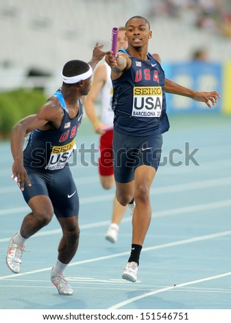 BARCELONA - JULY, 14: Eric Futch(L) and Quincy Downing(R) of USA competes on 4X400 Relay of the 20th World Junior Athletics Championships at the Olympic Stadium on July 14, 2012 in Barcelona, Spain - stock photo