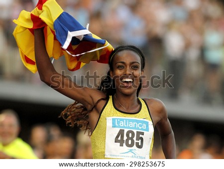BARCELONA - JULY, 8: Ethiopian athlete Genzebe Dibaba celebrating victory in 1500 meters of the Athletics International Meeting at the Serrahima Stadium on July 8 2015 in Barcelona, Spain - stock photo