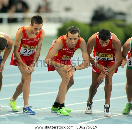 BARCELONA - JULY, 10: Group of Athletes during 10000m event of the 20th World Junior Athletics Championships at the Olympic Stadium on July 10, 2012 in Barcelona, Spain - stock photo